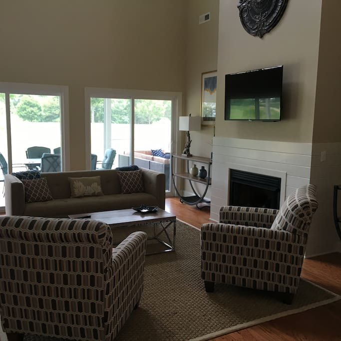 Living Room has generous, comfortable  seating and large screen TV.