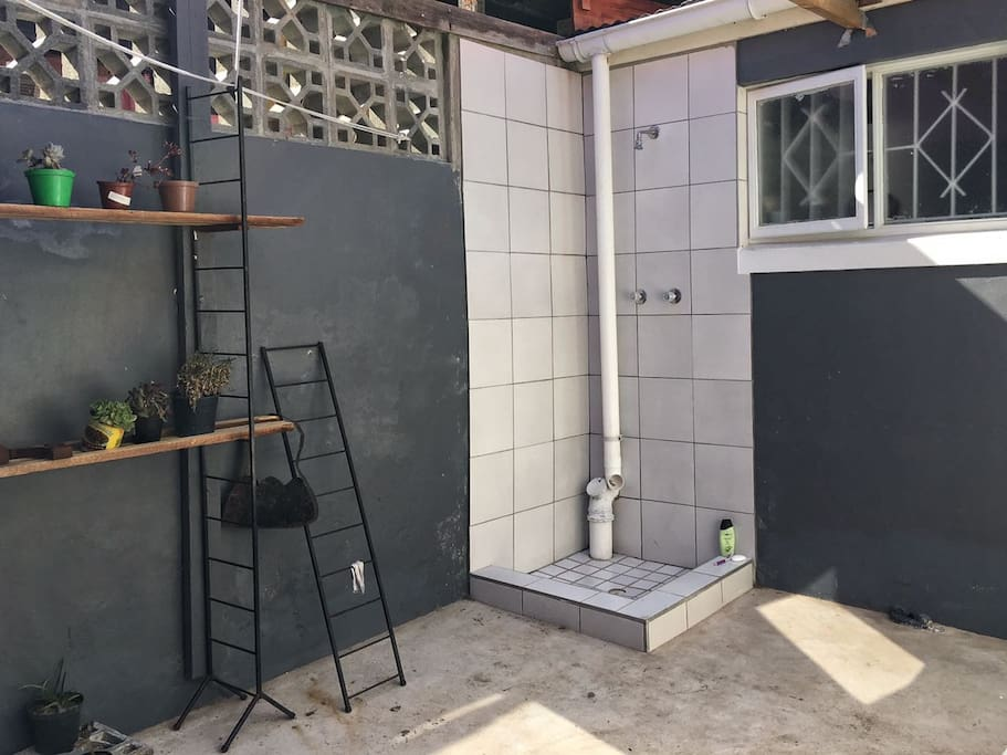 The outdoor area, complete with an outdoor shower.