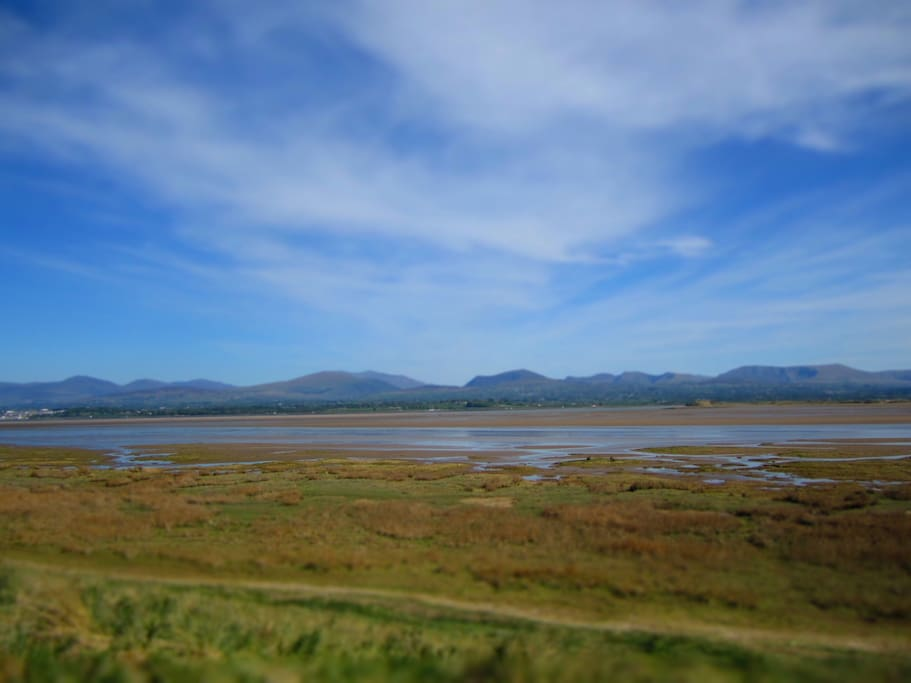 Views of Snowdonia over the marsh from the cob (dyke)