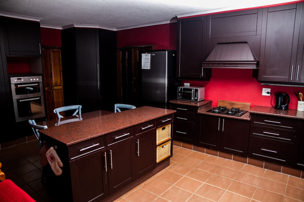 Kitchen area, with seating. Stove, Oven and Microwave facilities.