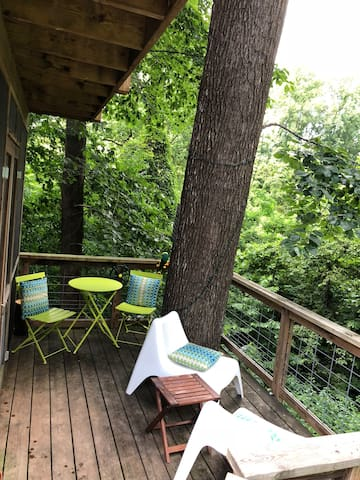 Enjoy your lush surroundings from the deck of the treehouse. The deck is solar-powered with string lights, giving it a gorgeous, romantic ambiance at night.