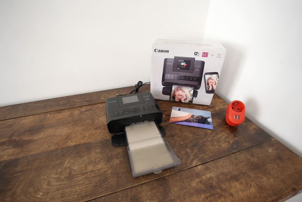 And what do we offer here? A Canon Selphy printer with some paper in it, where you can print out your pictures or make postcards and send it to your loved ones