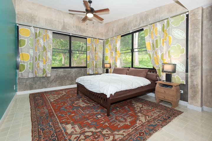 The master bedroom has windows on two sides...the entire house has mosquito netting...so you can sleep in the cool mountain air in the middle of a jungle, yet with all creature comforts.