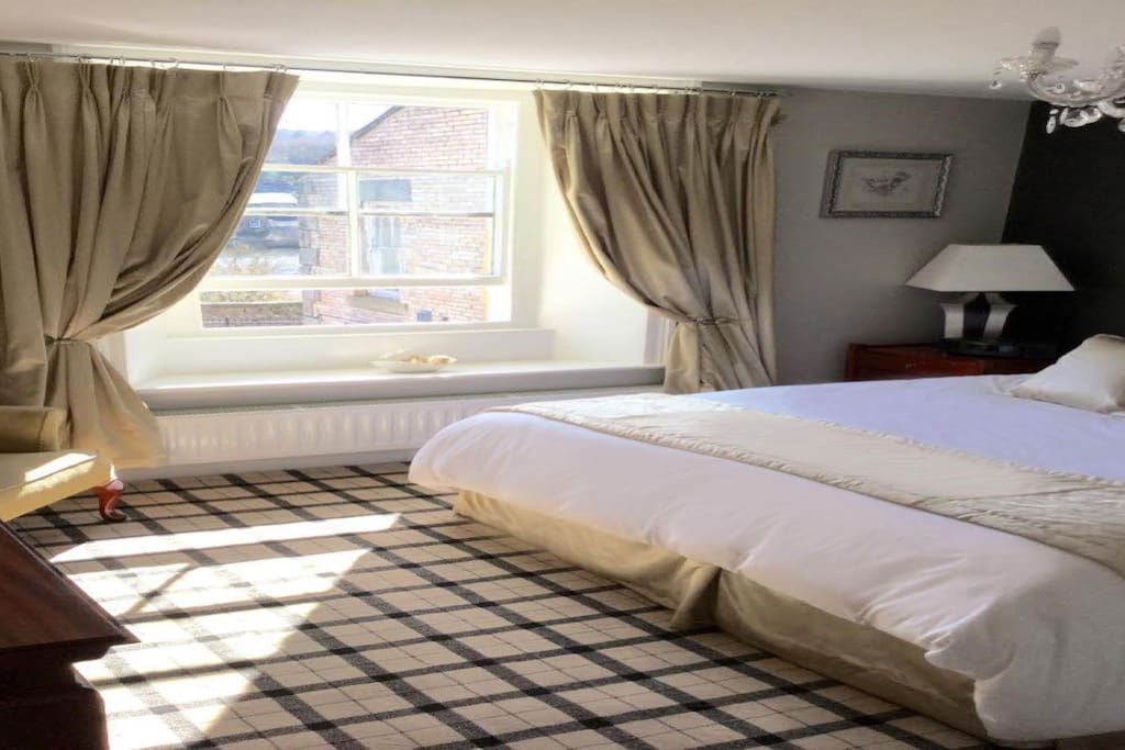 Ratcliffe Room overlooking the South river Tyne with supper king bed.