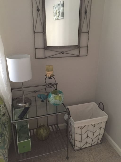 Nightstand with extra lighting, room also has desk and chair ( not shown)