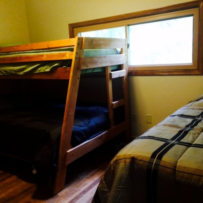 The middle bedroom with a twin/full bunk and another twin.