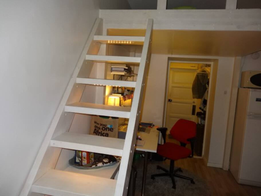 Staircase leading to loft bed