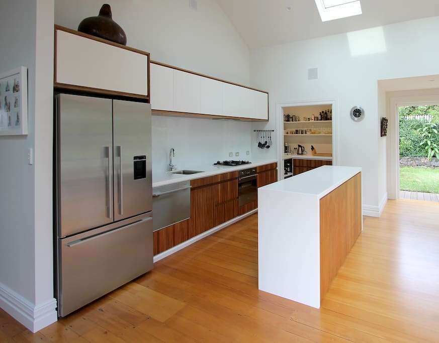 Modern well stocked kitchen with scullery.