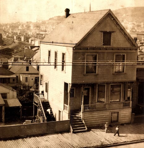 Circa 1900~1910, this photo was given to me by Mary, the previous owner whose grandfather built it in 1890 and operated a blacksmith shop to the left of the house (but not shown in the picture.)   Mary's mother Anna is sweeping the side stairs.
