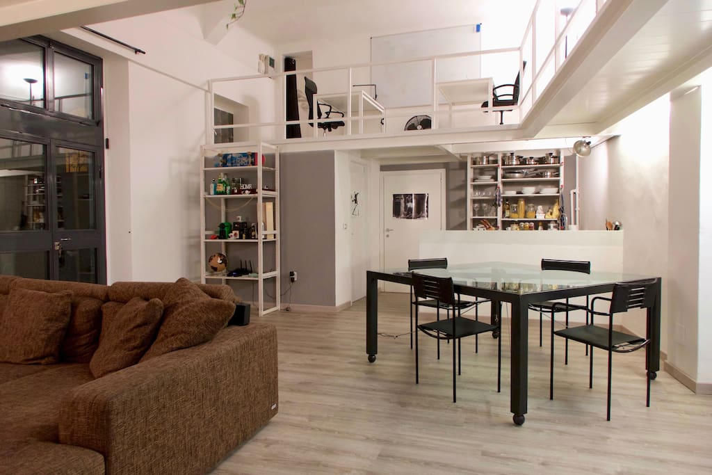 Open Space Living Room with Dining Table, Kitchen and Office on the Mezzanine