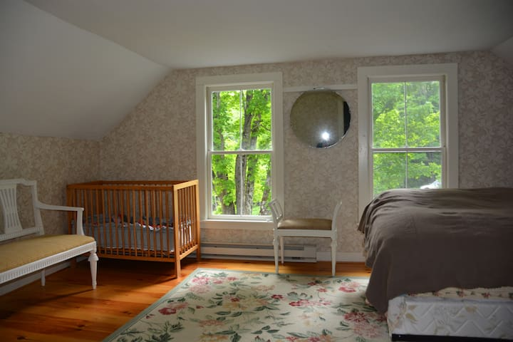 The Back bedroom is at the end of the hall - it's a bit removed, large and pleasant. Bedroom #5 has a queen and a twin as well as an optional crib which is stored in a nearby closet.