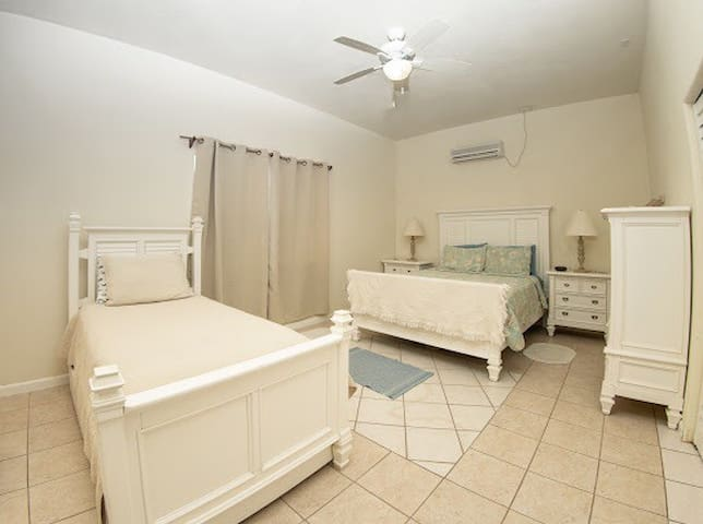 3rd bedroom. Garden and bluff view.  Double bed and twin bed with trundle. Sleeps 4.