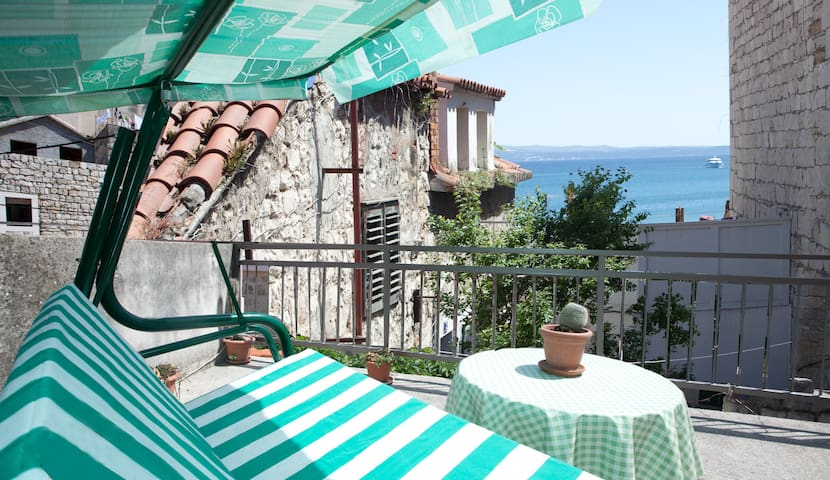 Sunny terrace with little sea view