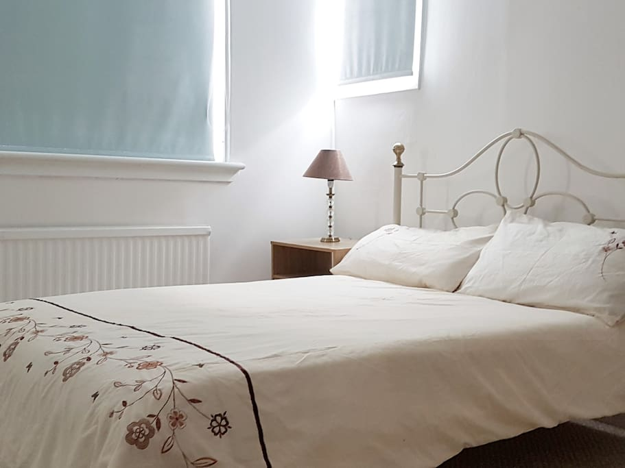 Light and airy double bedroom for one  to two guests priced at £55 per night .
