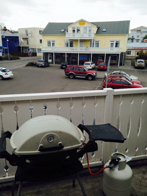 Gas grill on large back balcony.