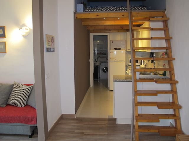 The kitchen and a foreground of the stairs