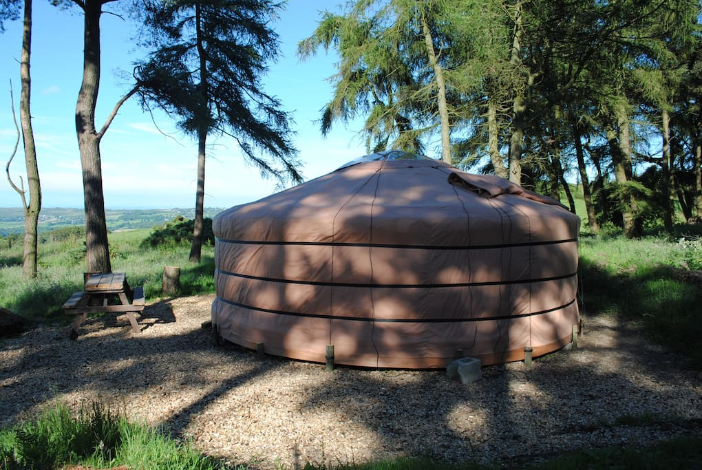 Evening view of our yurt overlooking valley