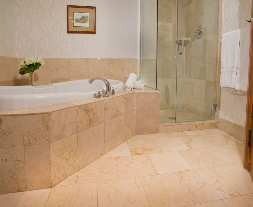 Prepare for the day in the luxurious marble bathroom.
