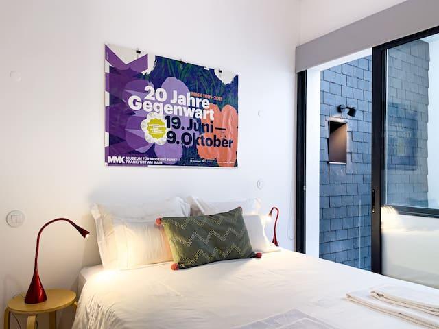 Cozy bedroom full of natural light
