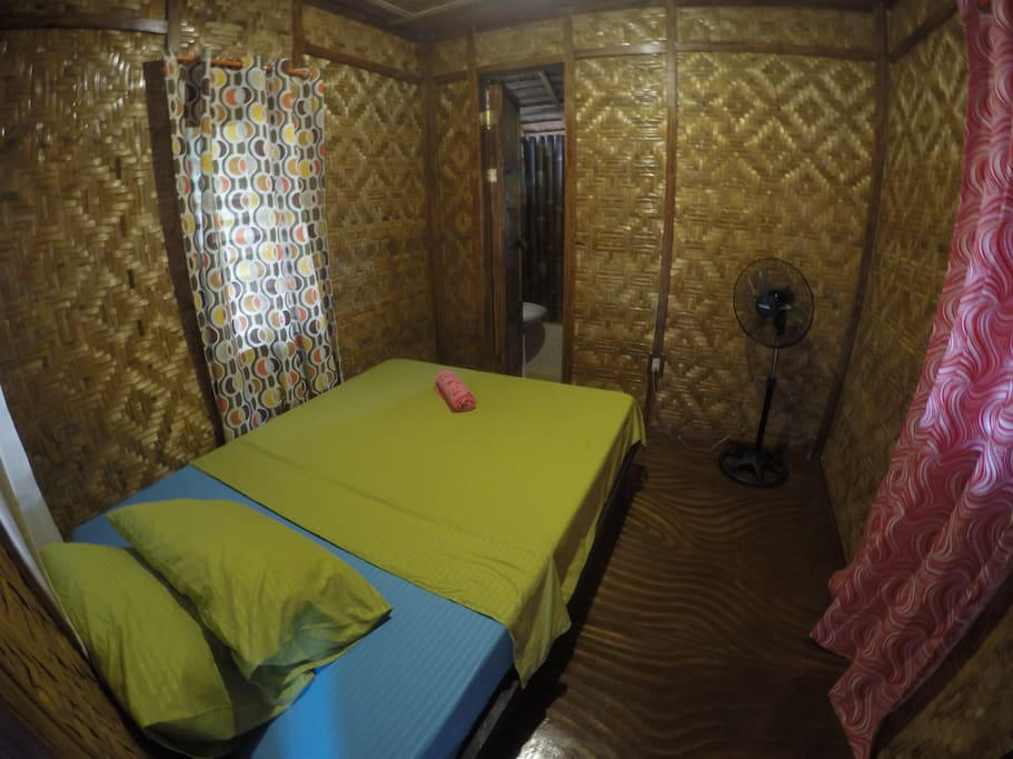 Room with mosquito net and stand van