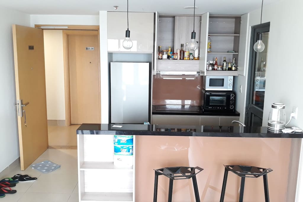 Kitchen with full equipments. From knife, spoon, dishes,... To other ingredients for cooking.