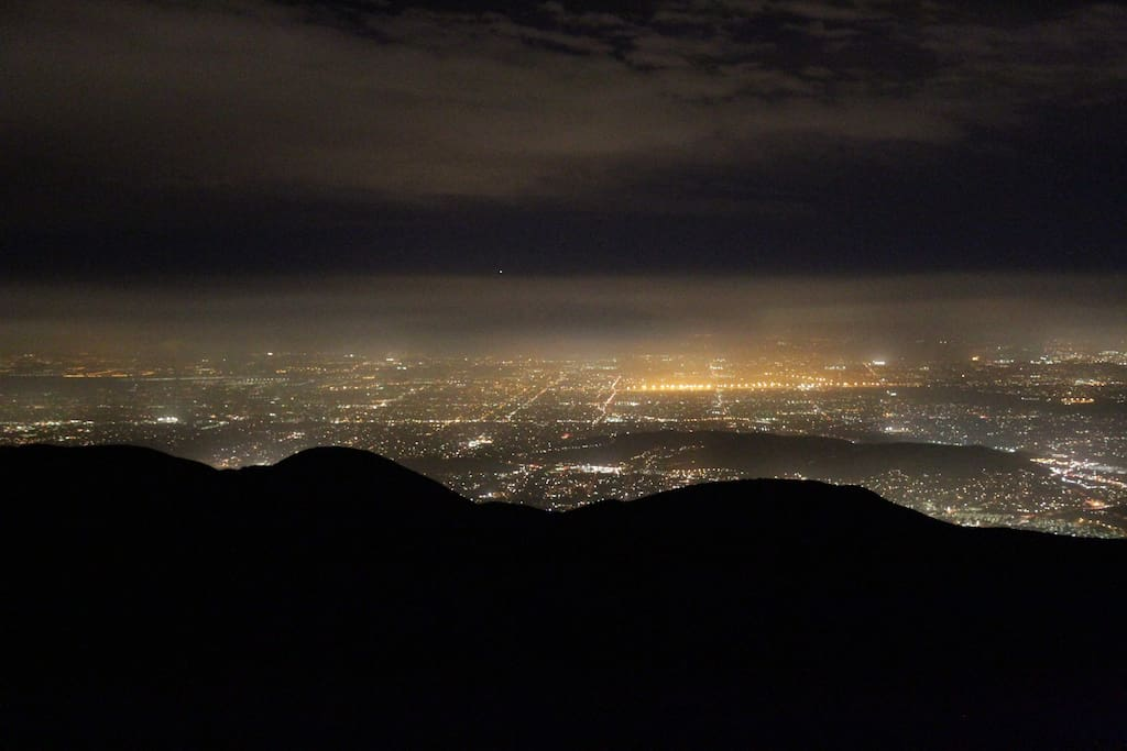 spectacular nighttime views of the city from the mountain top - this is photographed on the deck