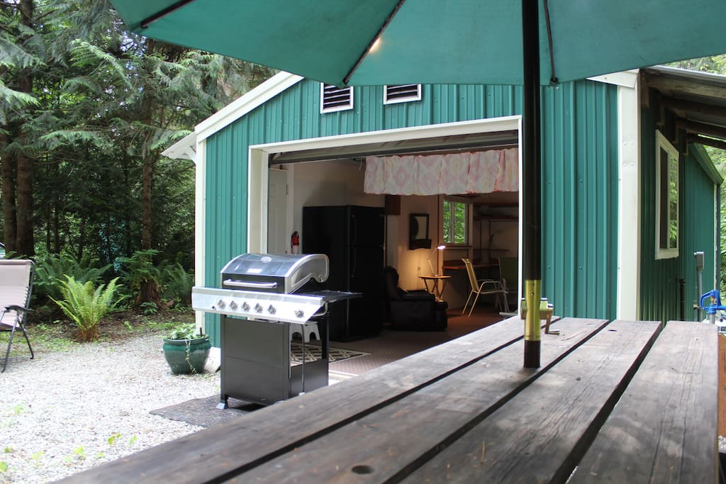 The garage door opens up to great outdoor living.