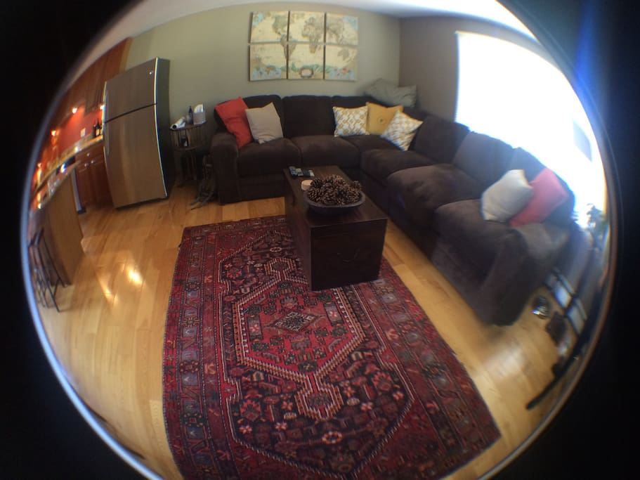 Living room / dining / kitchen share the open top floor. (We took several fisheye lens photos to give you a wider view.)