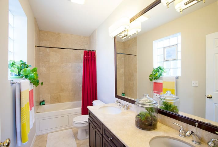 large bathroom with double sink and Jaccuzi tub