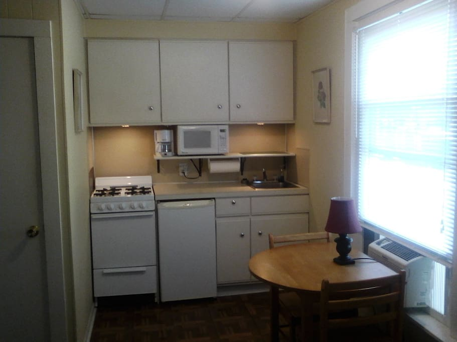 Complete kitchen with electric stove, small refrigerator and microwave. Cook a quick meal and save on restaurants or bring home leftovers from your favorite restaurant.