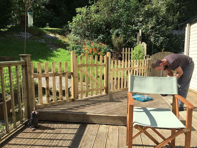 Decking area. Patio chairs kept in home.