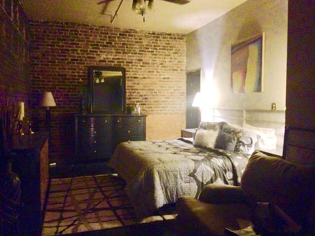 This is the bedroom. Has a tv with a direct tv cable box in the room