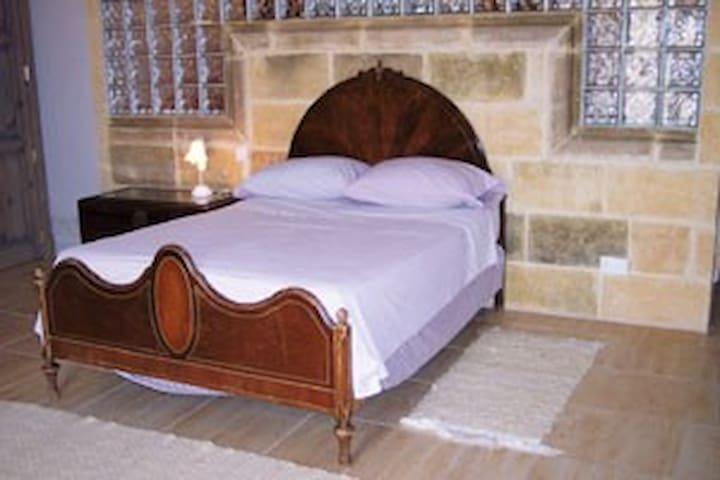 Georgine - a double & single bed.