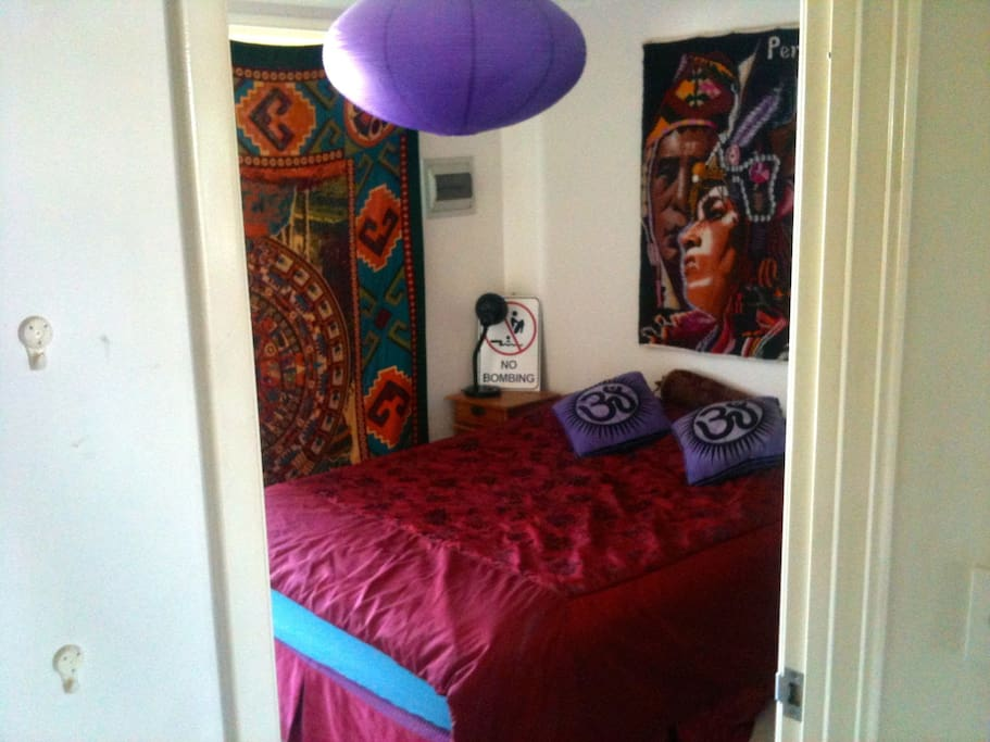 Vibrant colorful bedroom with comfy queen size bed