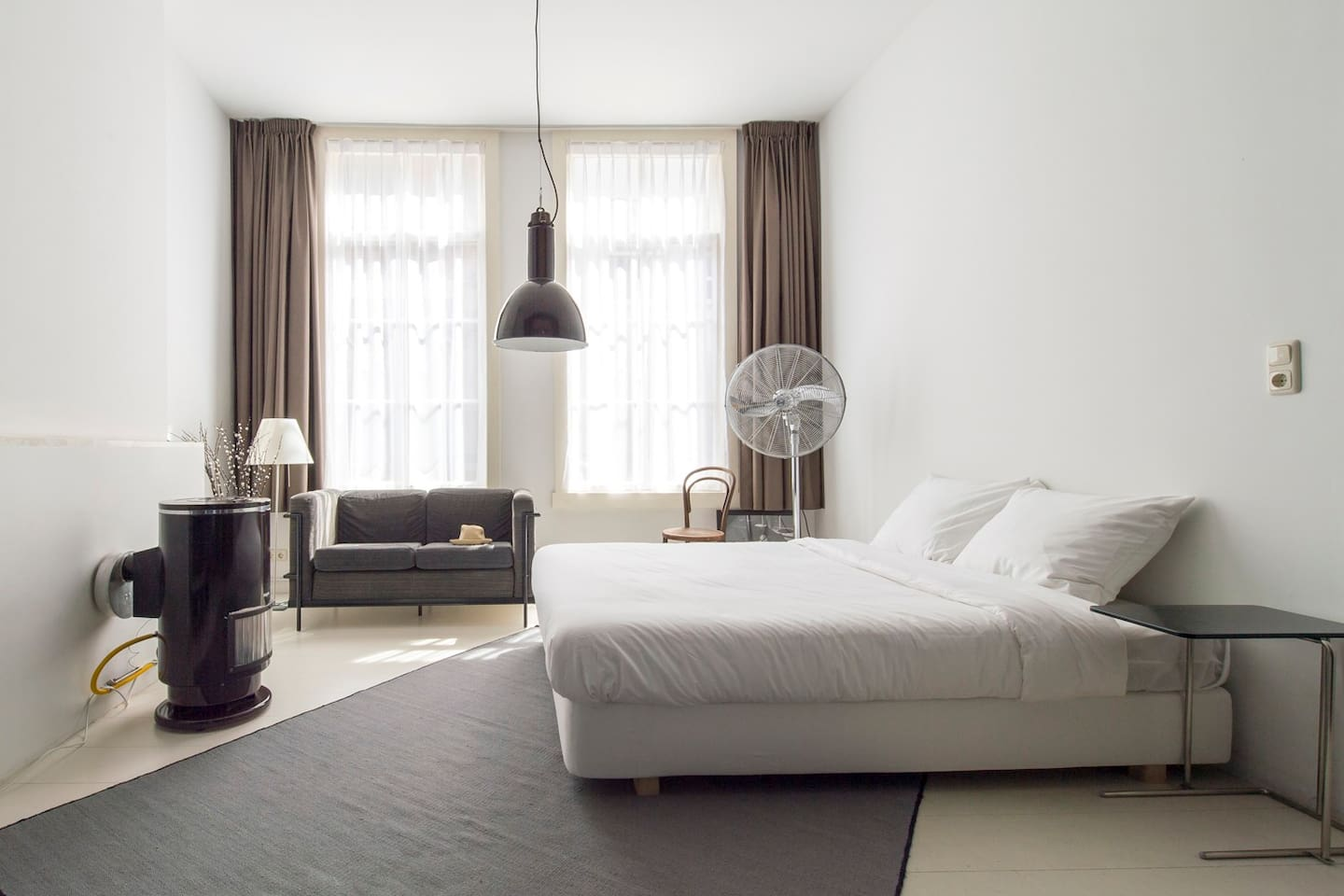 comfortable bed, professional hotel sheets, couch, heating, white painted real wood floor, carpet, lamp