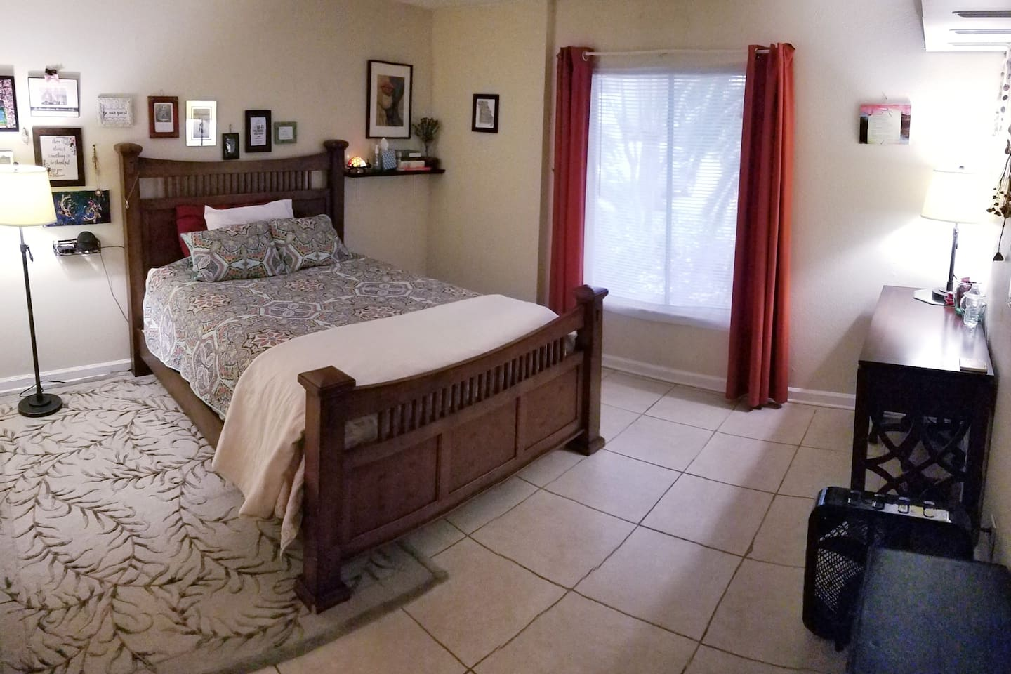 (1) Your room,  the Zen Bedroom with queen bed, aromatherapy diffuser, gentle lighting, and a desk.
