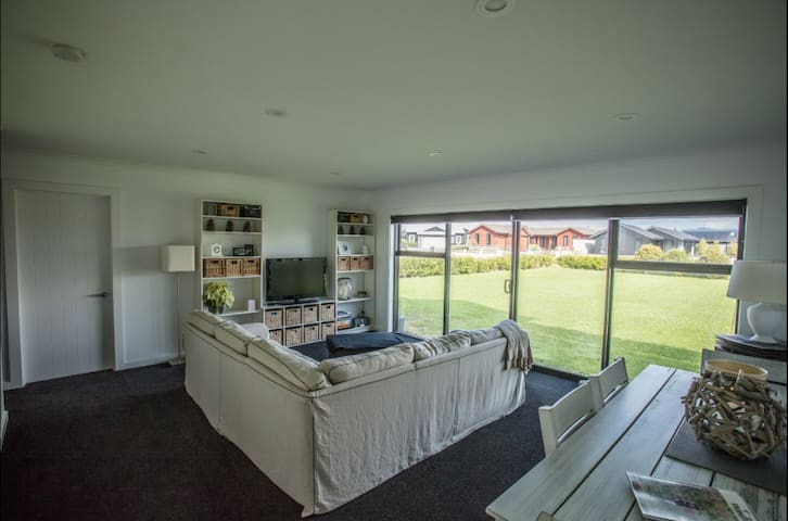 The living/dining area which leads out onto the front lawn now with large patio area. Sky TV and DVD player.