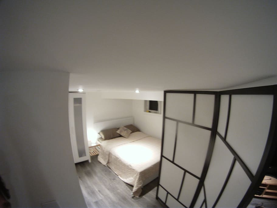 Sleeping area with double bed and closet