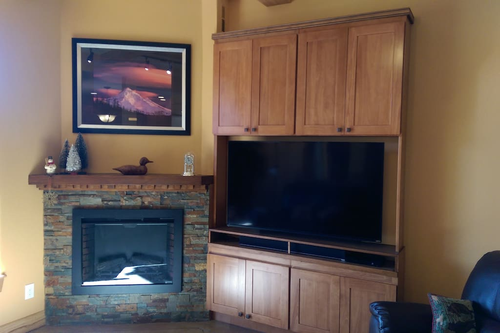 60 inch TV with fireplace.