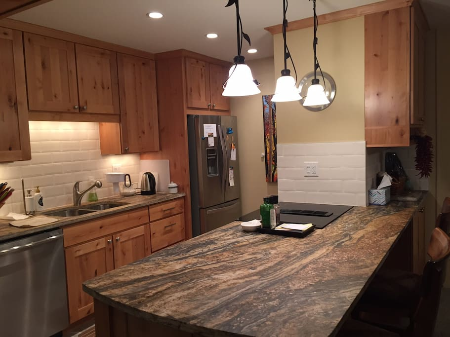 Remodeled kitchen with stainless steel appliances. Dishwasher, coffee maker, crock-pot