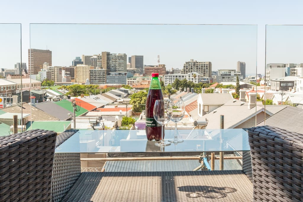 Enjoy the Summer Breeze, on your own personal balcony with a view of Cape Town City.