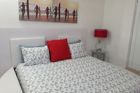 King bed apartment a 15 min del aeropuerto!