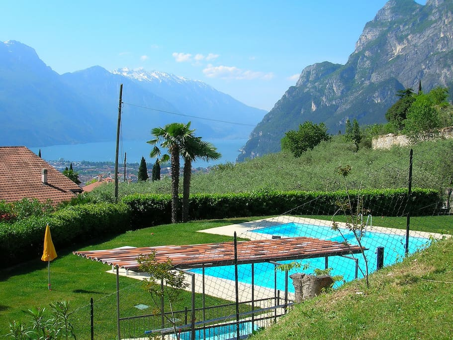 The swimming pool with the view on the Garda Lake