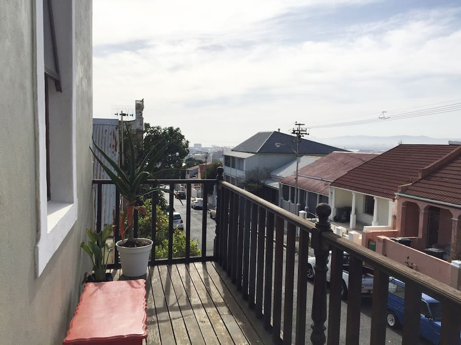 Main Bedroom balcony with small views of harbour and Devil's Peak/Tablemountain to other side