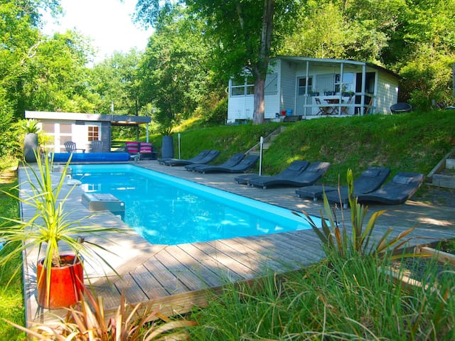 Our new poolhouse with shaded area perfect for poolside massage. Chalet 4 above the pool