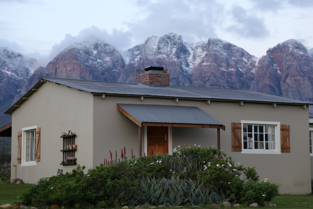 Merlot Cottage with snow on mountains in the background!