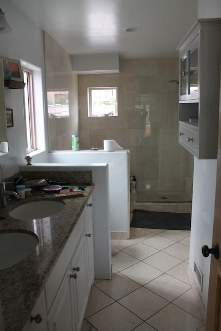 Shared Master Bathroom with two sinks, shower and 6' bathtub.
