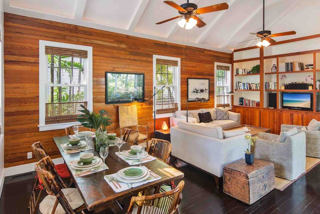 The spacious living area has a vaulted ceiling and overhead fans...
