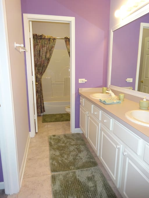 Dual sinks, toilet, combo shower/bath
