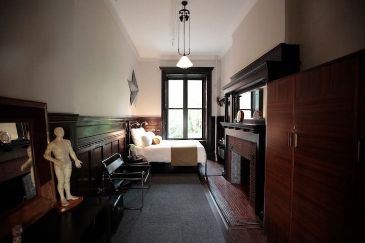 Private panelled bedroom.